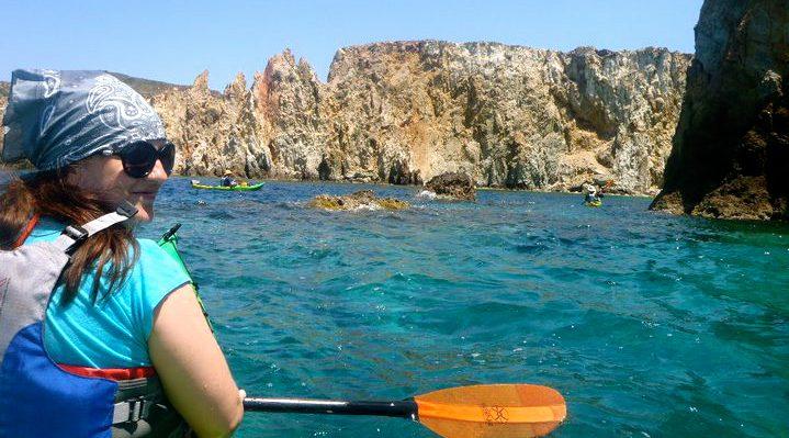 Kayaking around the island of Milos, Greece.