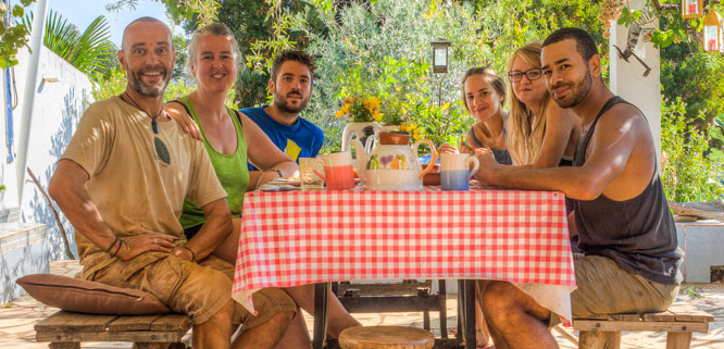 people-gathering-food-table-community