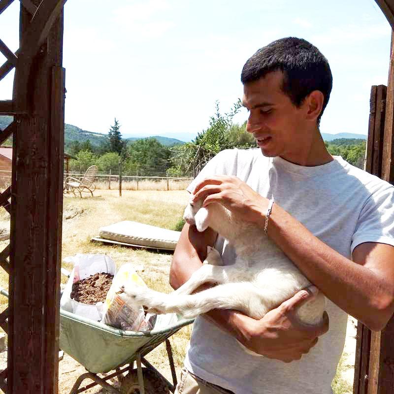 traveller-volunteer-holding-goat-skills